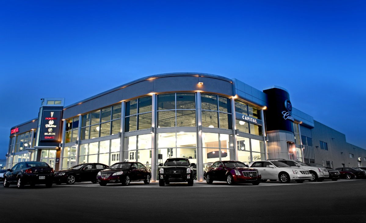 photo of GM auto dealership at night