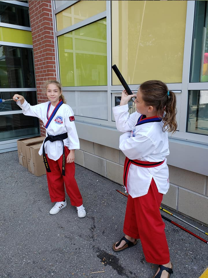 Warming up outside of the local school%2C before self-defense demo class