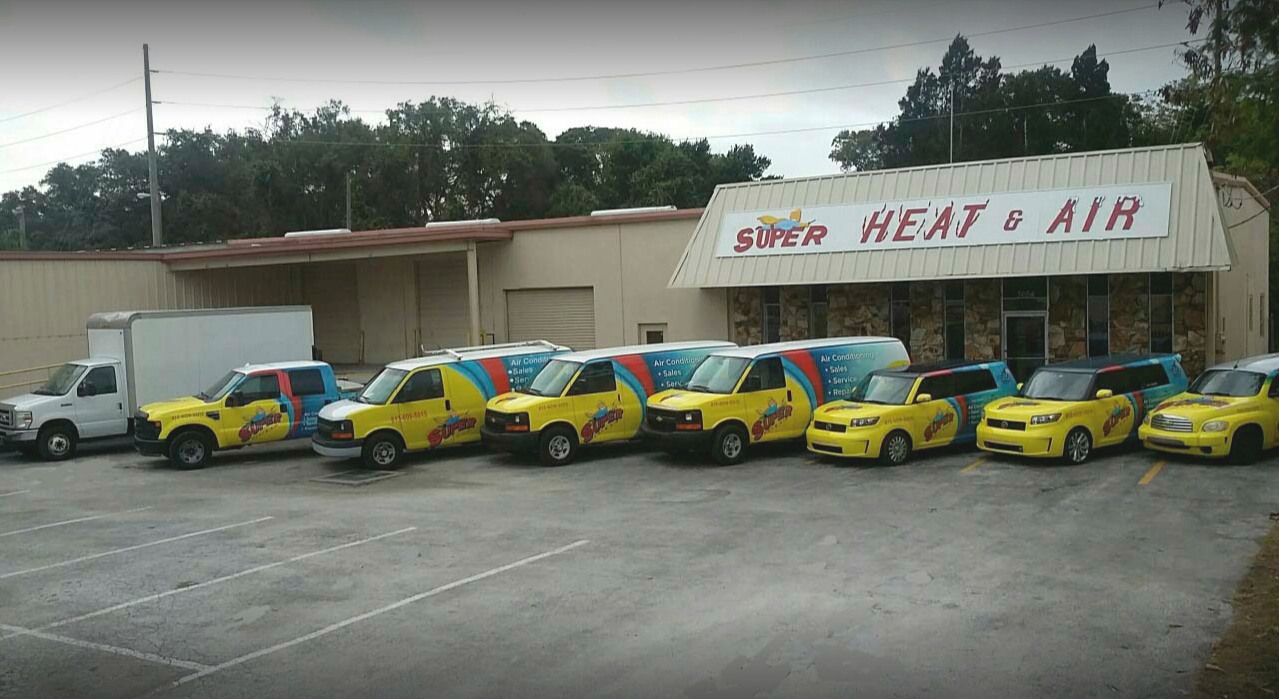Photo of Super Heat & Air service vehicles outside of head office, Tampa